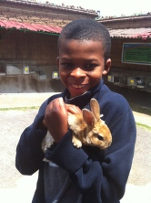 Smiling with a baby bunny!!