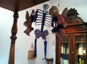 Items hung from the bed of Frida